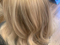 Choppy blonde Hairstyle with gentle wave