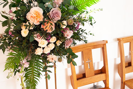 pastel floral arragnement at wedding venue, The Old Parish Rooms, in Rayleigh