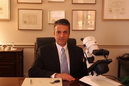 Gino at Diamond desk 3.jpg