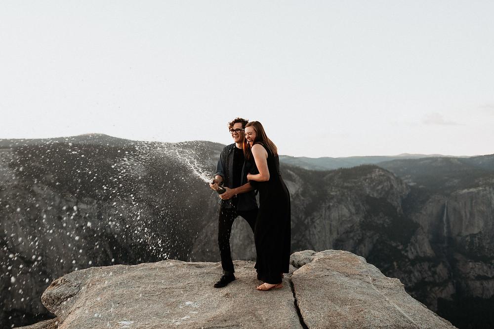 Taft Point Yosemite Engagement Photos champagne pop
