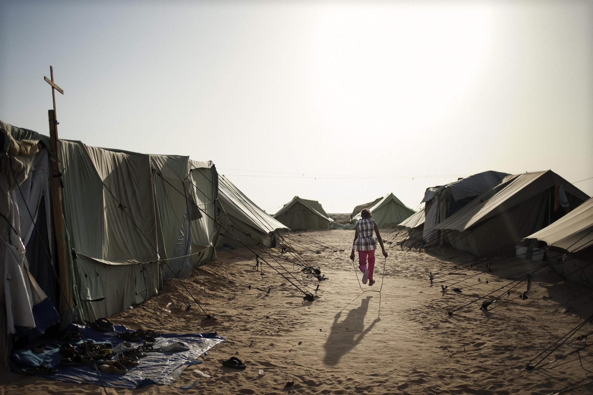 51c31f56b3fc4bc6cb00007b_a-refugee-camp-