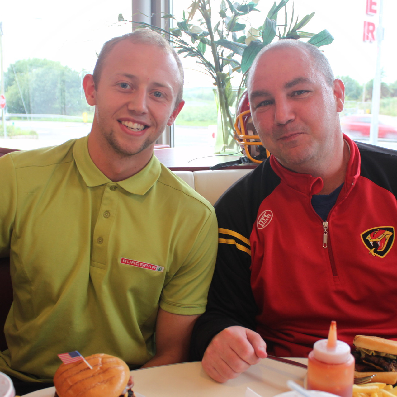 John Fullerton and Coach Brock enjoy a Viper Burger in Kernans Diner
