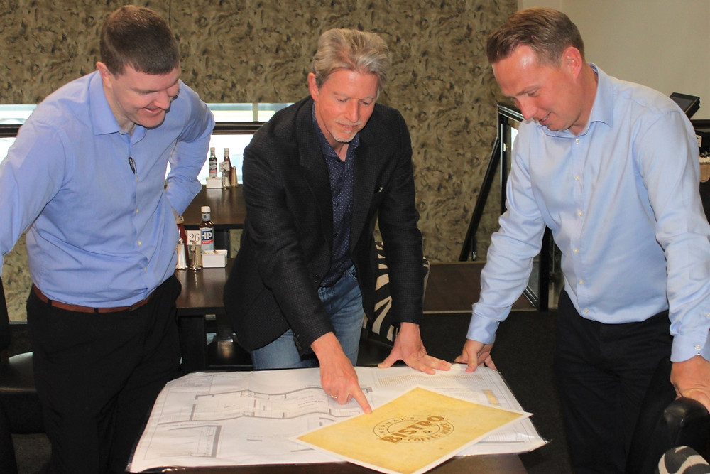 Paul, Anthony and Damian look over the plans