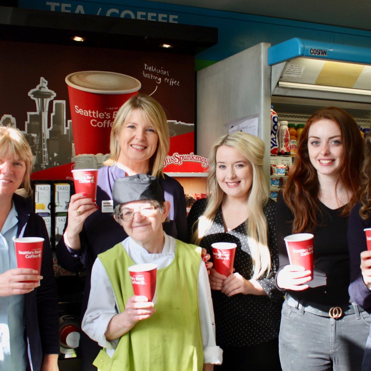 Kernans Letterkenny. Marie Mc Donald pictured with Kernans Manager Mary Black, Jemma McLaughlin, Joey Kelly, Siobhan Cox and Caroline Sweeney from the Hospice