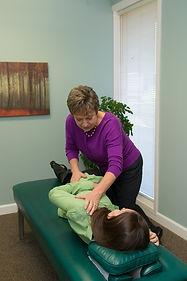 Chiropractic adjustment of a teen