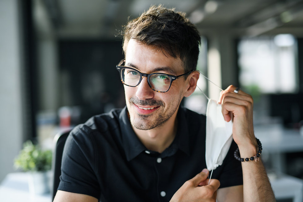 portrait-of-young-man-back-at-work-in-of