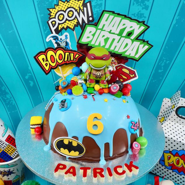 Superhero Chocolate Piñata Smash Cake