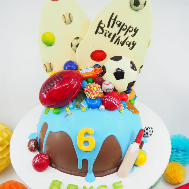 Sports Themed Chocolate Piñata Smash Cak