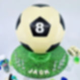 A 3D life sized Soccer Ball Smash Cake -