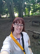 Stacey in the woods in Scout uniform