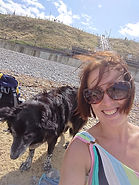 Stacey with dog on beach