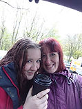 Stacey with girl drinking coffee in rain