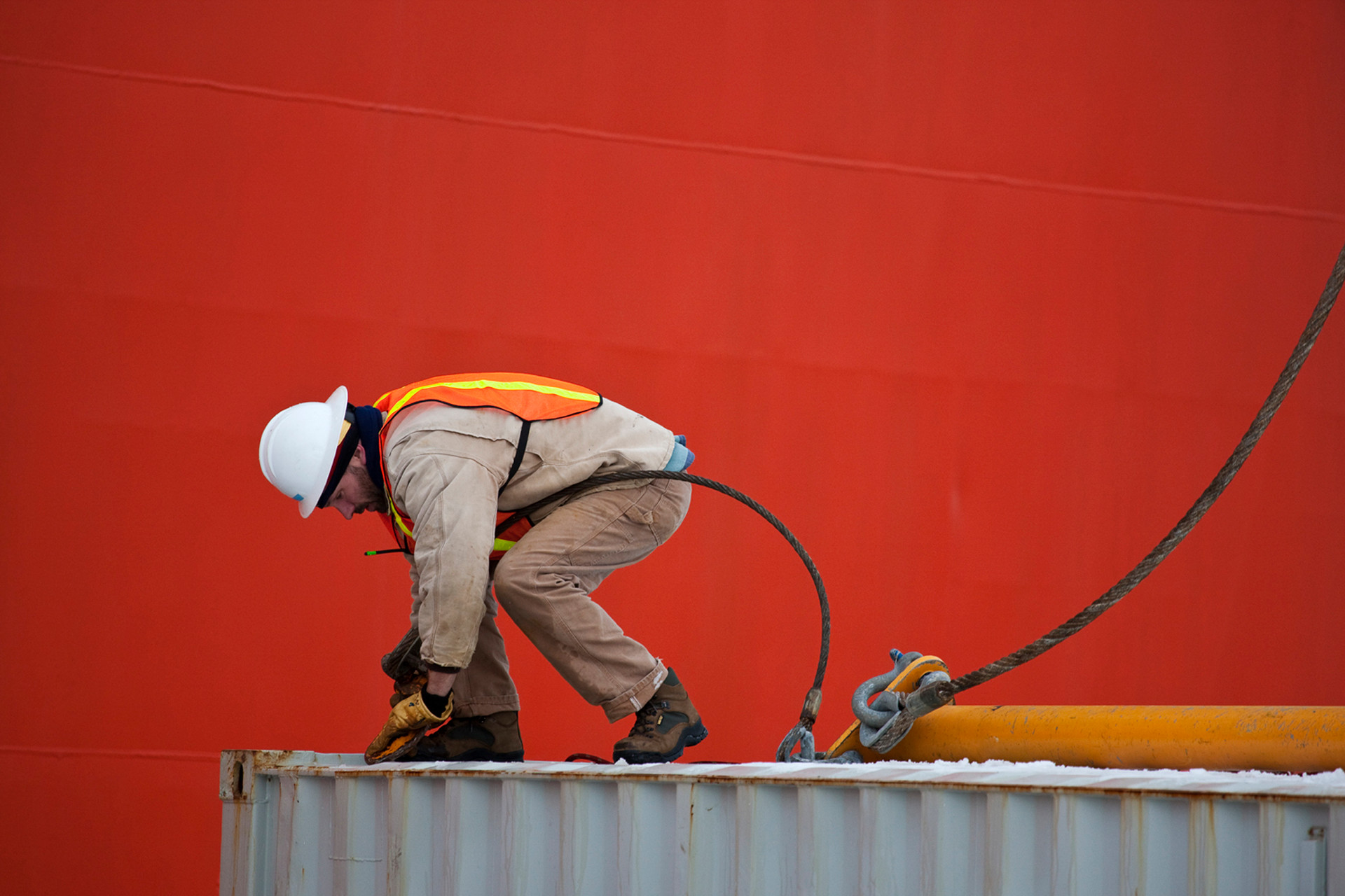 A worker connecting cables on the LM Gould Research Vessel. Palmer Station Antarctica, 2008