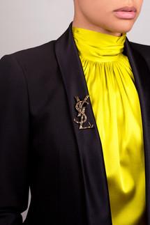YSL on a black blazer make any color pop!