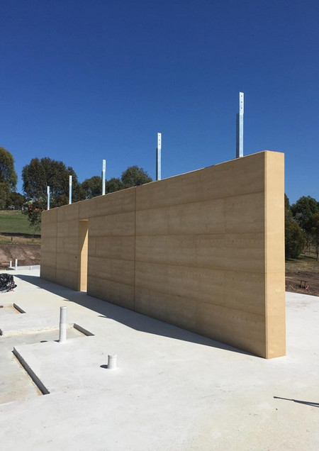 Olnee-rammed-earth-under-construction-16