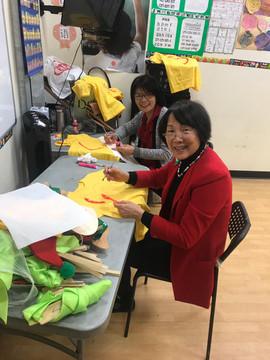 Teachers are workiong on kids costumes.j
