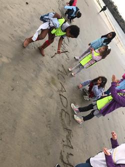 Writing All Star at beach sand