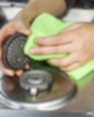 Hands with microfiber cloth cleaning gas