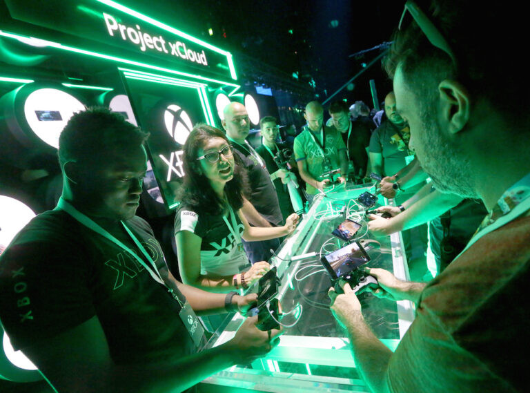 Gamers try out Project xCloud at the Xbox 2019 E3 Showcase in the Microsoft Theater at L.A. Live, Monday, June 10, 2019 in Los Angeles. (Photo by Casey Rodgers/Invision for Xbox/AP Images)