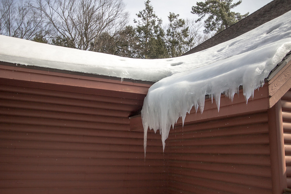 ice and snow melting off a slanted roof