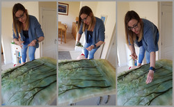 placing wool fibres on a large woodland commission