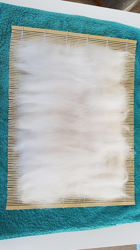 layers of white merino wool