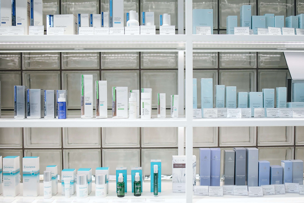 Shelves of bottles and packaging of new face products that are ready to be sold
