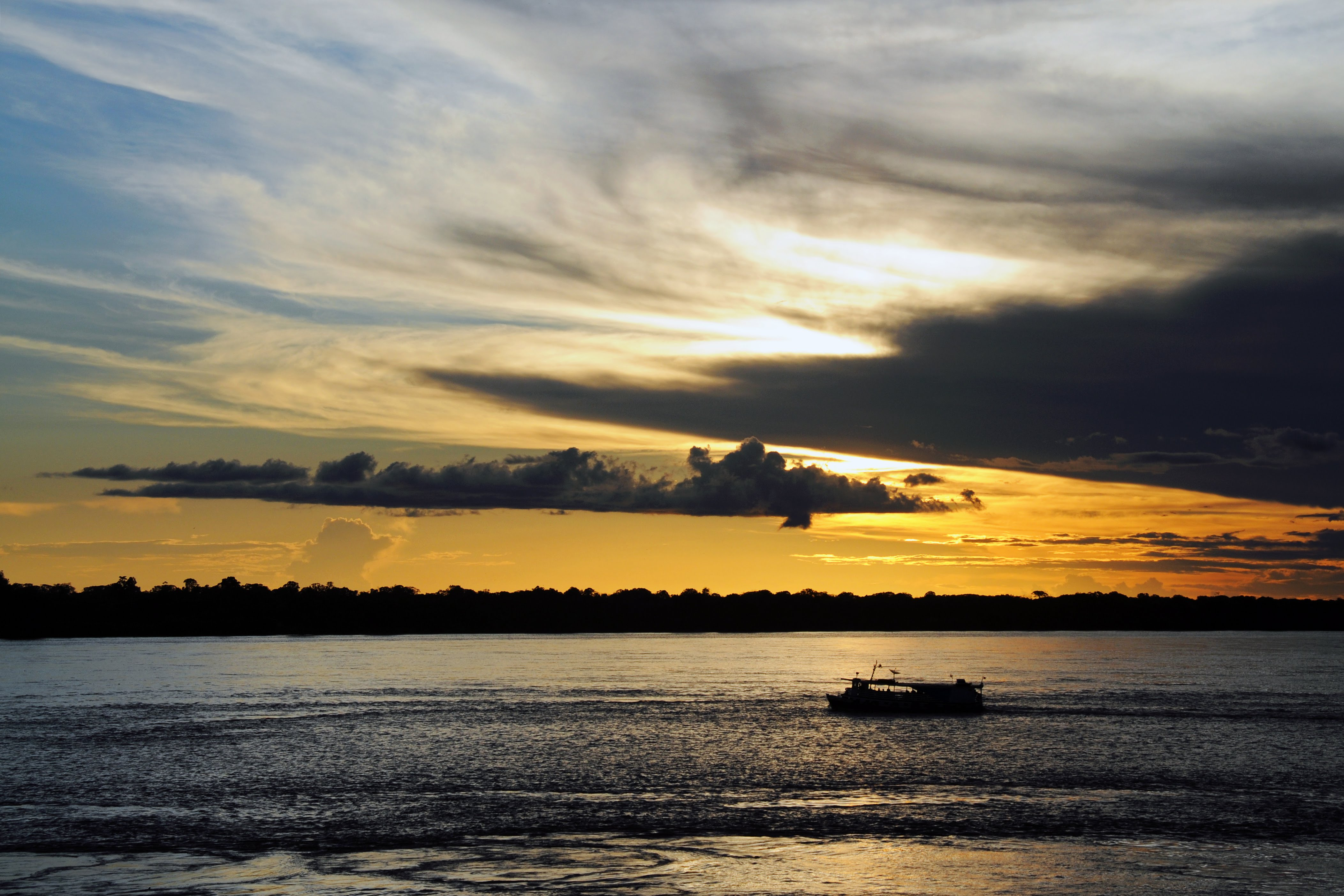sunset-over-amazon-river-tabatinga-brazil_23122734395_o