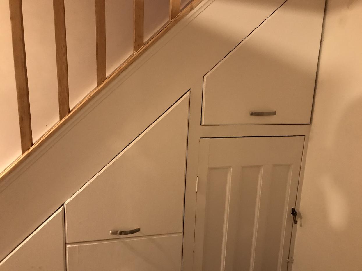 Under stairs storage.HEIC