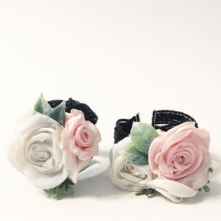Two corsage cuffs that include flowers made from the Bride's christening gown back int he 70's.