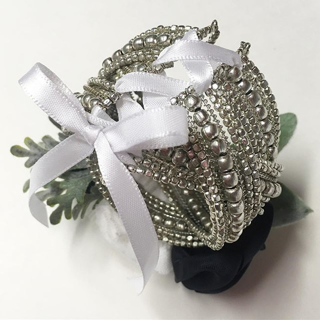It's all in the details. The back of this corsage is laced up to make sure it fit's.