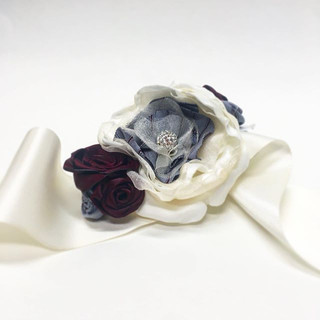 A corsage for the Bride's mother hand sewn using her late Father's button down shirt. A heart was sewn under the corsage (as a surprise) to sit against her Mother's radial artery (the artery that leads to her heart). It's to make sure she knows her husband is there with her.