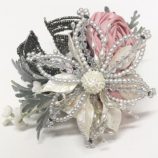 We wanted to make this Mother of the Bride's corsage extra special. So, we took a beautiful beaded cuff, added a beaded flower that her mother had worn on her wedding day in her hair, her late husband's boutonniere, in addition to pieces that were taken from her granddaughter's bridesmaids dress when they were altered to be made into pink roses.