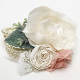 A surprise pearl corsage for a Mother that is made from the Bride's late father's shorts and her parents original satin ring pillow from their own wedding, this corsage is filled with love and meaning.