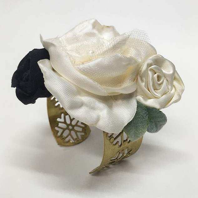 A unique MOTG's corsage that is not only made from her son's (the Groom) NYPD blues, but features a gorgeous metal filigree gold cuff.
