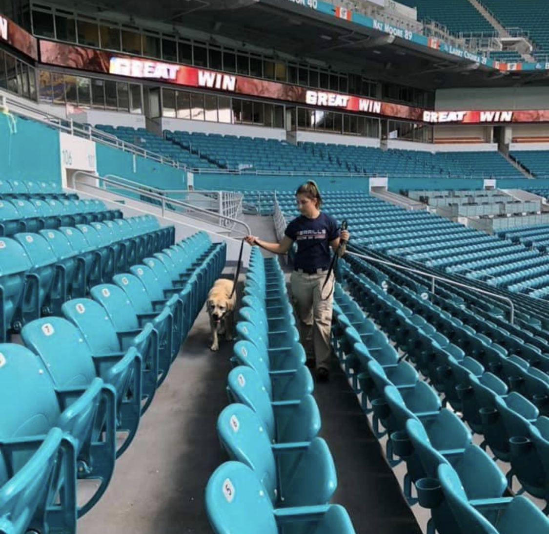 Bianca and K9 Hickory clearing Hard Rock Stadium