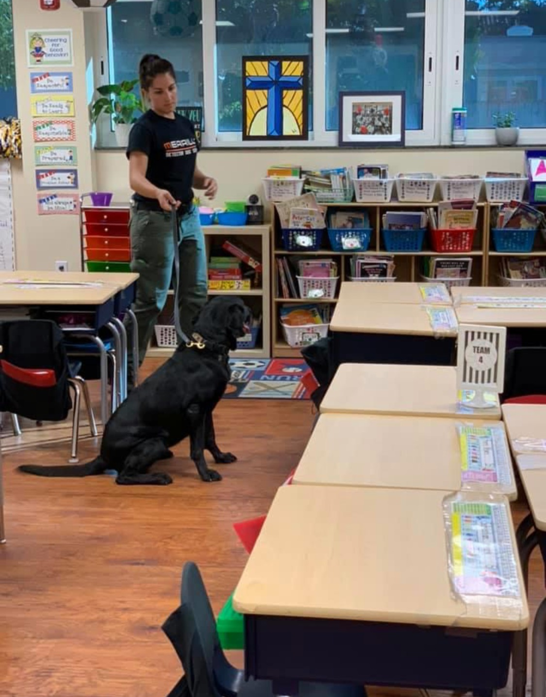 Bianca & a K9 searching a classroom.