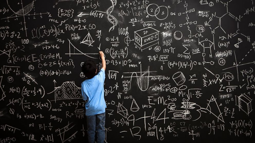 GTY_child_at_chalkboard_doing_math_jt_14