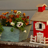 A close up view of a red hand made  farm