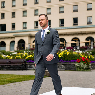 Grey two-piece suit with brown shoes and belt