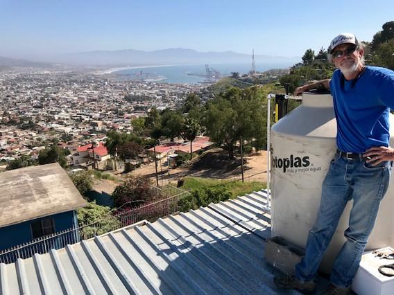 Luke installing new tank at Casa Josué
