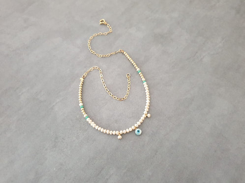 Eye and pearls Necklace