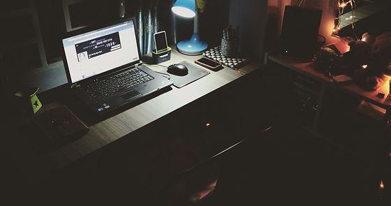black-laptop-beside-black-computer-mouse