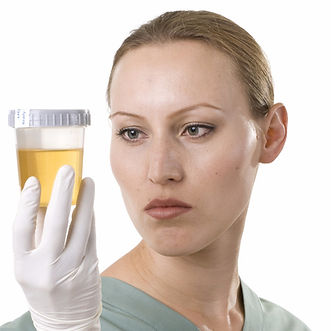 Female Medical Professional With Urine S