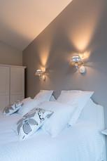 Détails des appliques en tête de lit