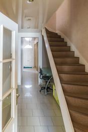 Couloir et dégagement en enfilade ponctué par l'escalier