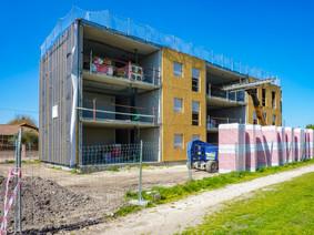 Construction d'un immeuble béton à façade bois