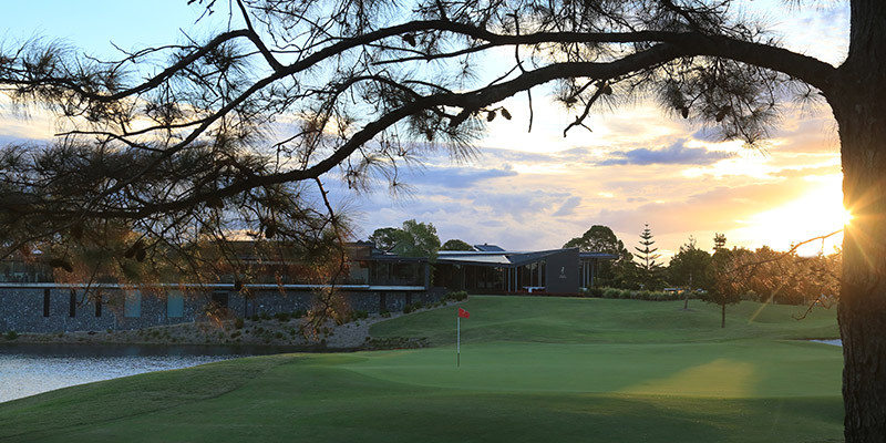 Clubhouse over 18th hole at Sanctuary Cove