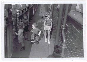 Hilton children playing on the balcony.j