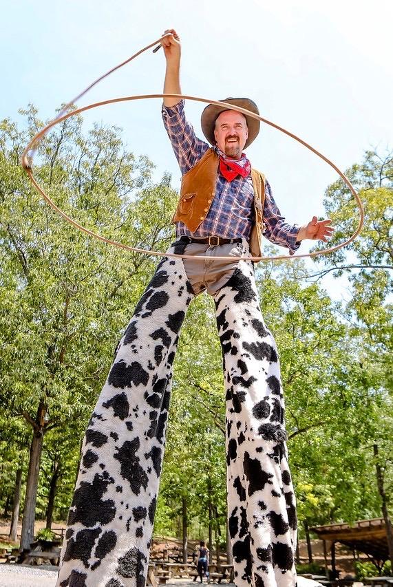 atlanta cowboy stiltwalker